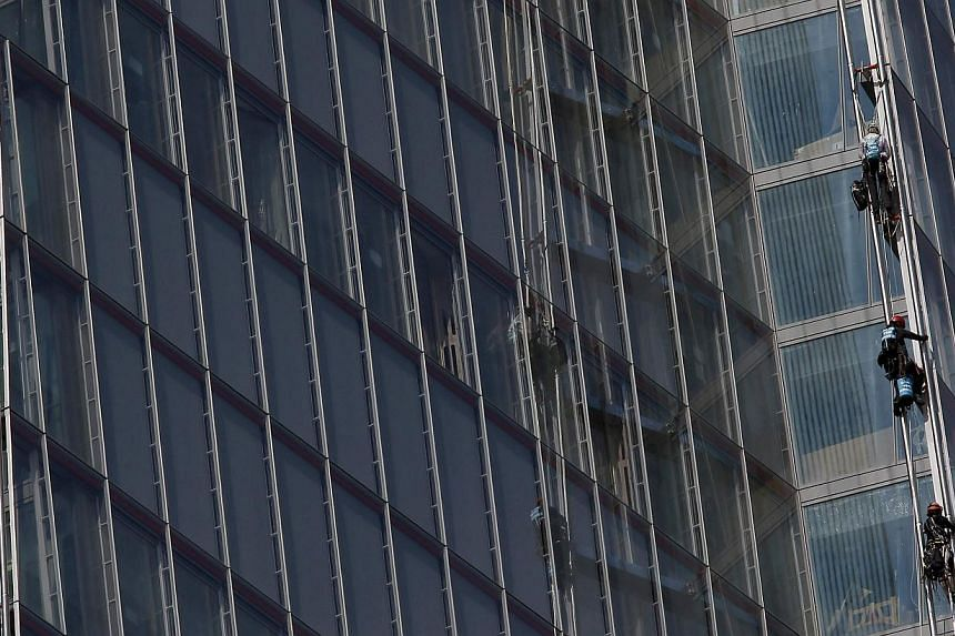 Greenpeace demonstrators climb the Shard skyscraper, in central London on Thursday, July 11, 2013. Six female Greenpeace activists attempted on Thursday to scale the Shard skyscraper in London, western Europe's tallest building, in a protest over Arc