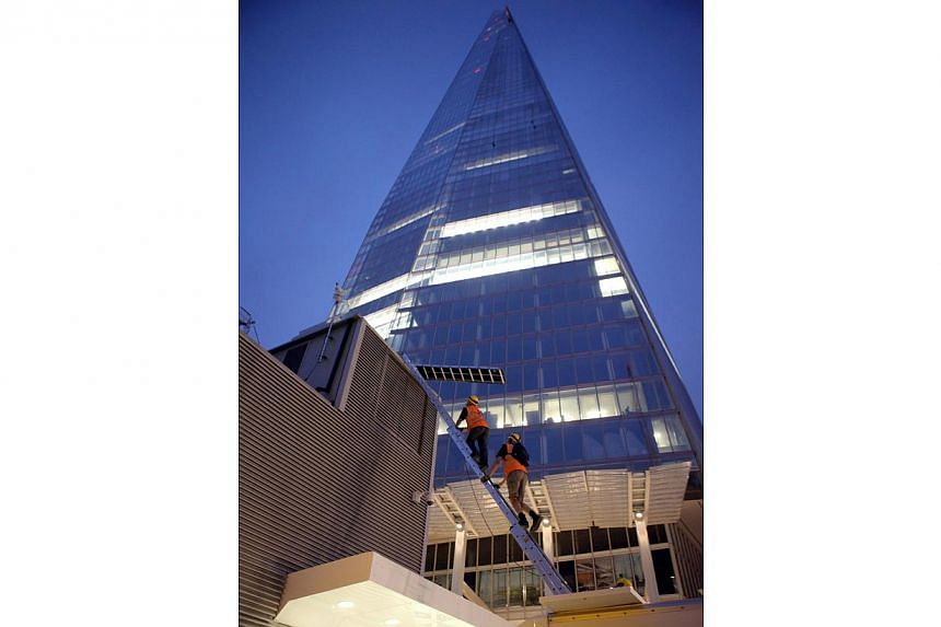 Greenpeace demonstrators start their ascent of the Shard skyscraper, in central London on Thursday, July 11, 2013. Six female Greenpeace activists attempted on Thursday to scale the Shard skyscraper in London, western Europe's tallest building, in a