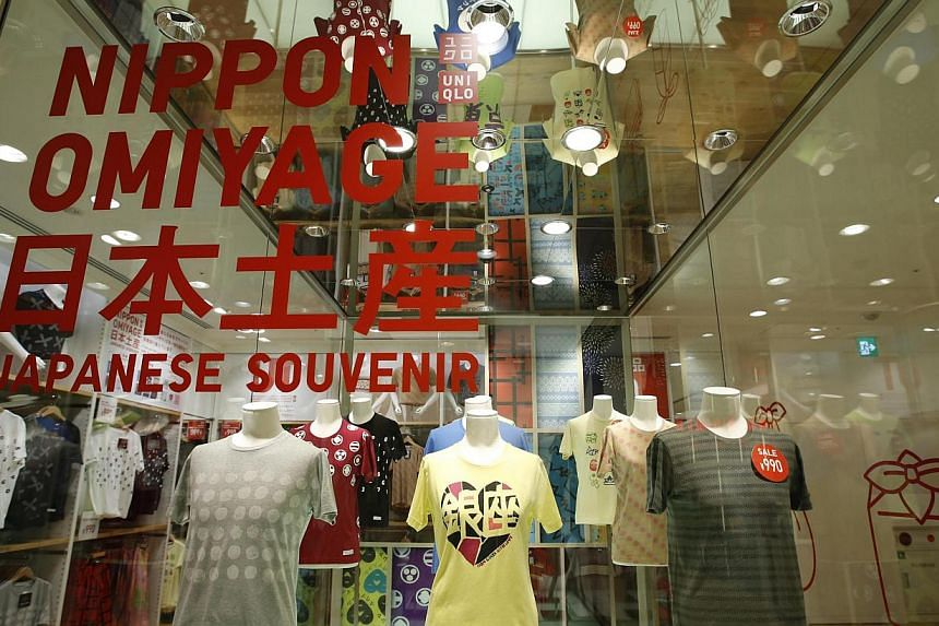 T-shirts are displayed at Fast Retailing's Uniqlo casual clothing store in Tokyo on Thursday, July 11, 2013.The operator of Japanese cheap-chic clothing chain Uniqlo said on Thursday it will open 10 new stores in the United States, as it report