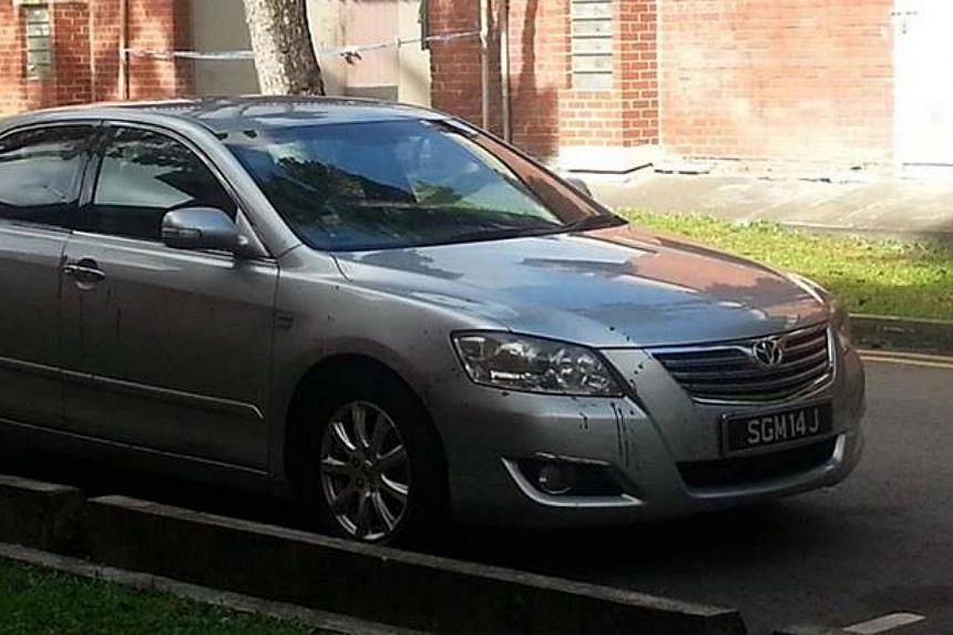Police have located the silver Toyota Camry with the licence plate SGM 14J, which was involved in the suspected double murder of a father and son in Kovan on Wednesday. The car was found along Block 1084, Eunos Avenue 7. -- PHOTO: WANBAO