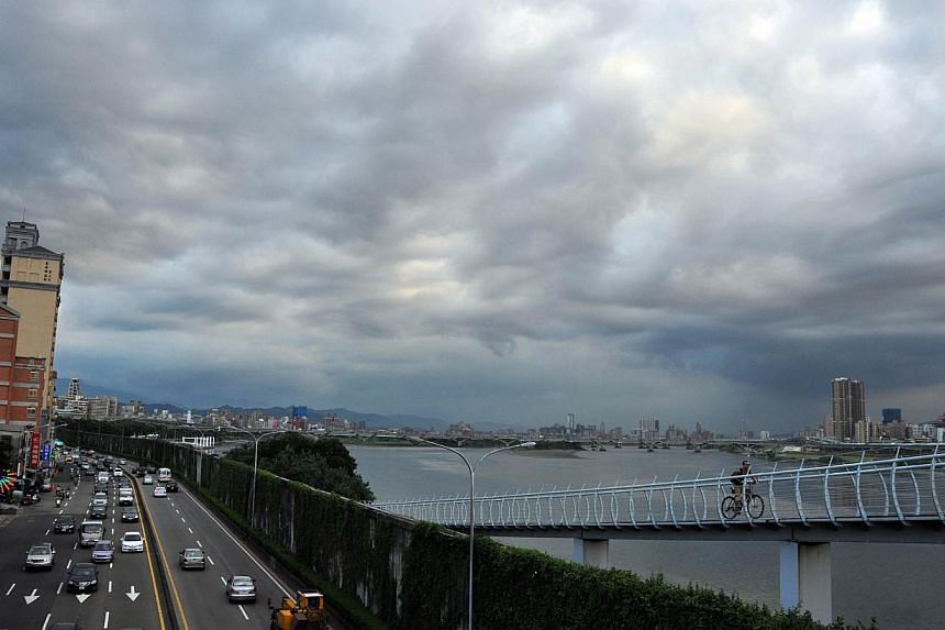 Dark clouds gather above Taipei on July 10, 2013. Typhoon Soulik is gaining momentum as it sweeps toward Taiwan, prompting the island's Central Weather Bureau to urge the public to heighten their vigilance against the storm. Taiwan evacuated more tha