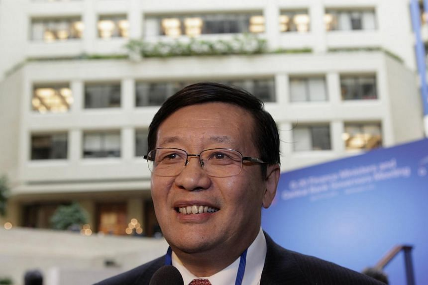 Chinese Minister of Finance Lou Jiwei smiles before the G20 finance ministers and central bank governors family photo during 2013 Spring Meeting of the International Monetary Fund and World Bank in Washington, on April 19, 2013. Mr Lou said he expect