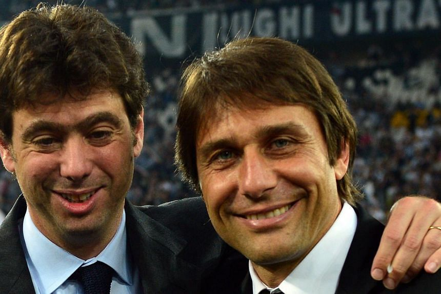 "Juventus' coach Antonio Conte (right) and Juventus' president Andrea Agnelli celebrate during the ceremony of the Scudetto, the Italian Serie A trophy after the Italian Serie A football match between Juventus and Cagliari at the ""Juventus Stadium"" in"
