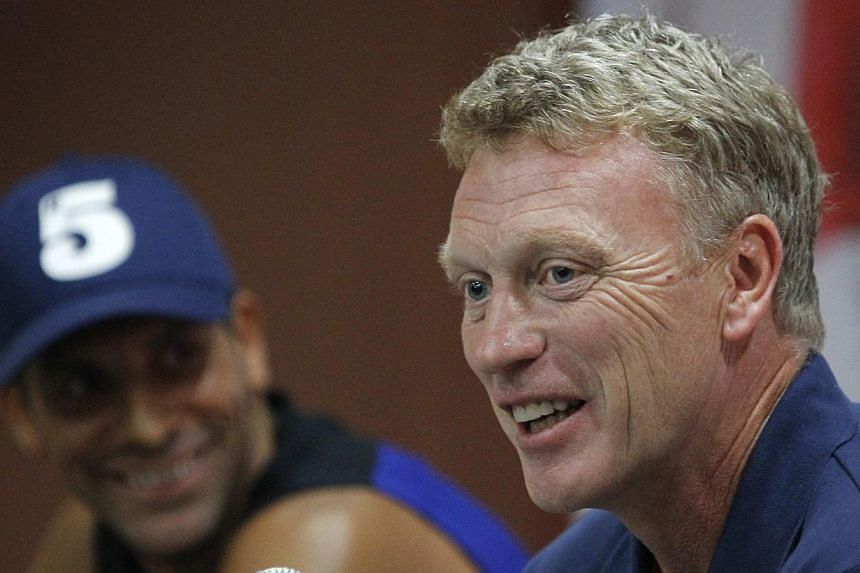 Manchester United manager David Moyes speaks during a news conference before a team practice session ahead of Saturday's soccer friendly against Thailand's Singha All Stars, as part of the team's Asia tour, in Bangkok on Friday, July 12, 2013.