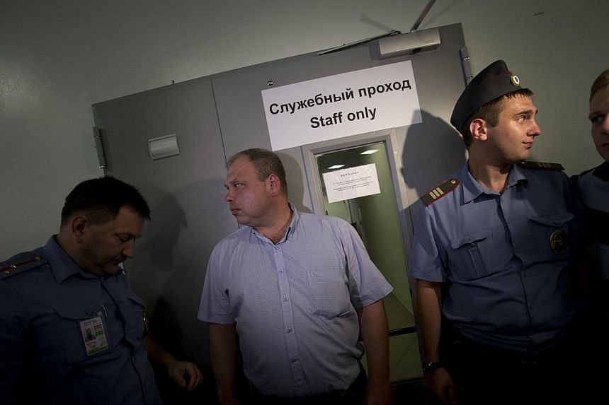 Police block the entrance to a transit zone at Sheremetyevo airport outside Moscow, Russia on Friday, July 12, 2013. Edward Snowden could stay in Russia if he stops issuing leaks that damage the United States, the Kremlin said on Friday after the US