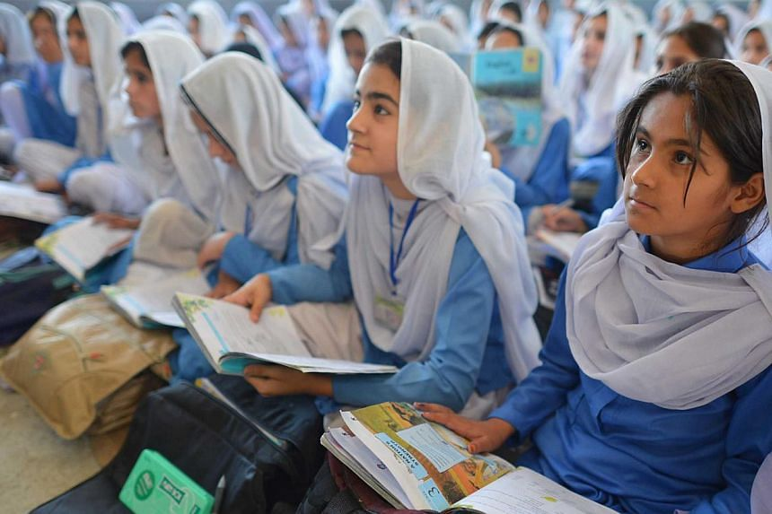 Pakistani girls attending class at a school in Mingora, the main town of Swat valley on June 21, 2013.Malala Yousafzai (not pictured) took over the United Nations on Friday, July 12, 2013, nine months after a Taleban gunman put a bullet in her