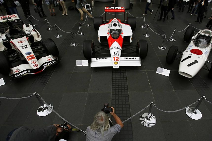(From left) The 2006 Honda RA106, 1988 McLaren Honda MP4/4 and 1965 Honda RA272 Formula One cars are displayed at the company headquarters in Tokyo on May 16, 2013. Japanese automaker Honda said on Friday it will build a European racing operations ba