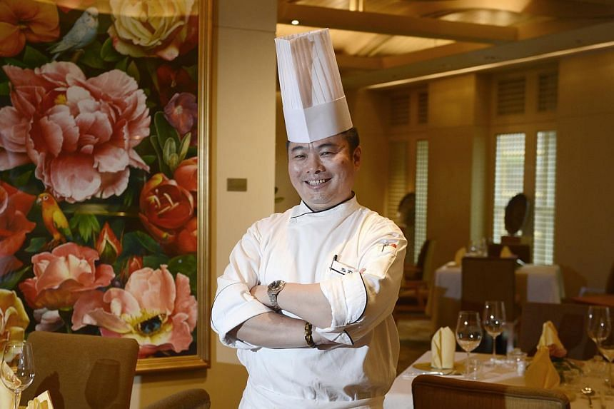 Chef Ku Keong, 48, shares the same birthday as Singapore's National Day - August 9, 1965 – an affinity that drew him to his new home country. -- ST PHOTO: DESMOND LIM