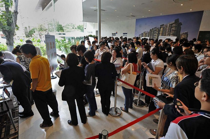 Prospective buyers and property agents queuing to check out the list of units at Bedok Residences on 23 Nov 2011. Agents are now urging regulators to take a stronger stand by forcing consumers to pay up.-- ST FILE PHOTO:RAJ NADARAJAN