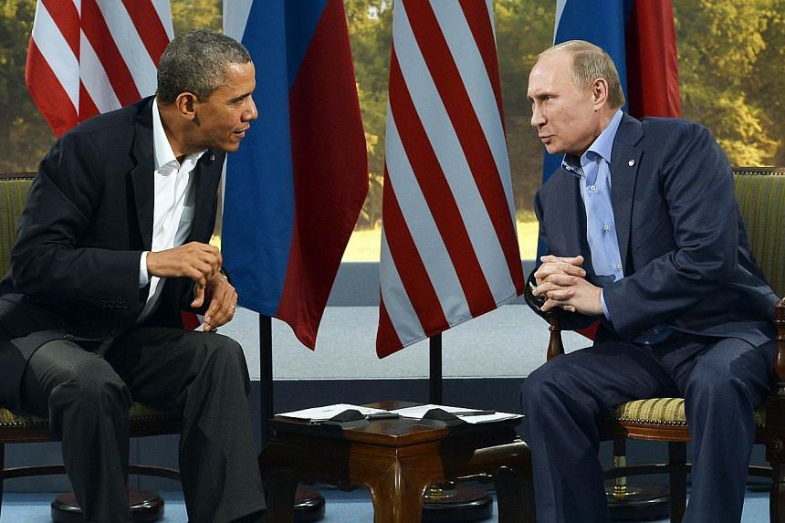 US President Barack Obama (left) holding a bilateral meeting with Russian President Vladimir Putin during the G8 summit at the Lough Erne resort near Enniskillen in Northern Ireland on on June 17, 2013. Mr Obama raised US concerns directly with Mr Pu
