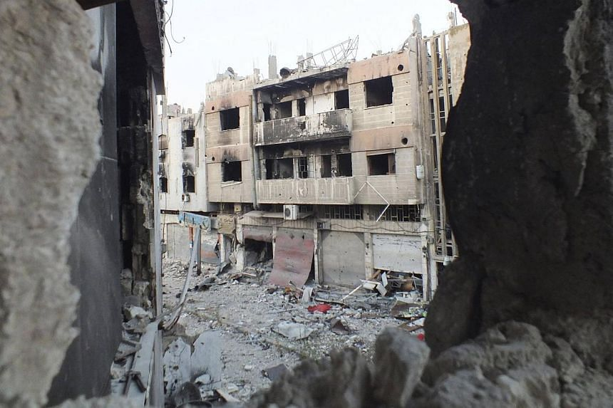 A view shows damaged buildings in the besieged area of Homs on July 12, 2013. The Red Cross appealed on Friday for a halt in the fierce fighting between President Bashar al-Assad's forces and rebels in the Syrian city of Homs, to bring in life-saving