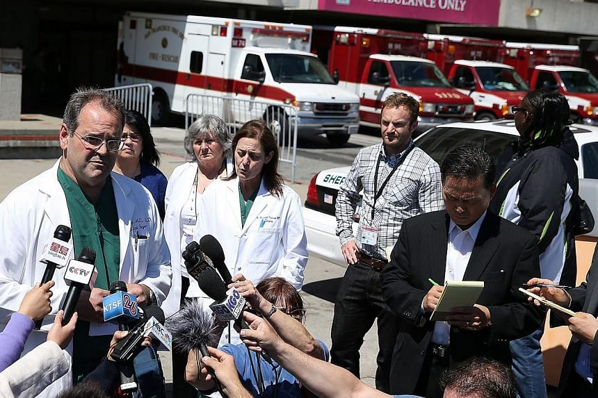 San Francisco General Hospital chief of neurology Geoffrey Manley (left) speaks to reporters at a news conference at San Francisco General Hospital on July 12, 2013 in San Francisco, California. Hospital officials announced a third victim from the cr