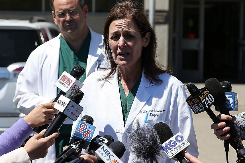 San Francisco General Hospital chief of surgery Dr. Margaret Knudson (right) announces the death of a third victim from the crash of Asiana Airlines flight 214 at San Francisco General Hospital on July 12, 2013 in San Francisco, California. Hospital