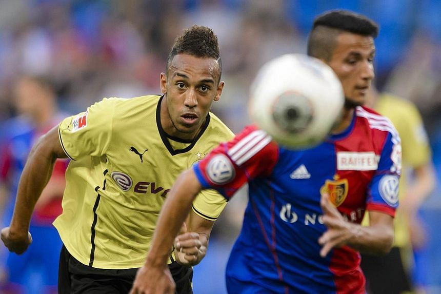 Dortmund's forward Pierre-Emerick Aubameyang (left) vies with FC Basel's Macedonian midfielder Naser Aliji during a friendly football match on July 10, 2013, in Basel. Aubameyang has clocked a faster time in sprint training than Olympic champion Usai