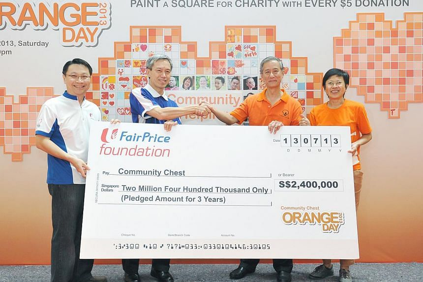 (From left) Mr Jonas Kor, Assistant General Manager of NTUC FairPrice Foundation, Mr Tan Kian Chew, Group CEO of NTUC FairPrice Co-operative Ltd, Mr Eric Ang, Vice-Chairman of Community Chest and Ms Ang Bee Lian, CEO of National Council of Social Ser