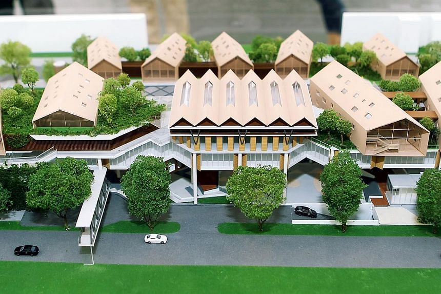 A model of the winning design of the Wisma Geylang Serai is shown on Saturday, July 13, 2013. Geylang Serai's new civic centre will have both traditional elements like a double-pitched roof and ketupat-inspired features, and contemporary ones like a