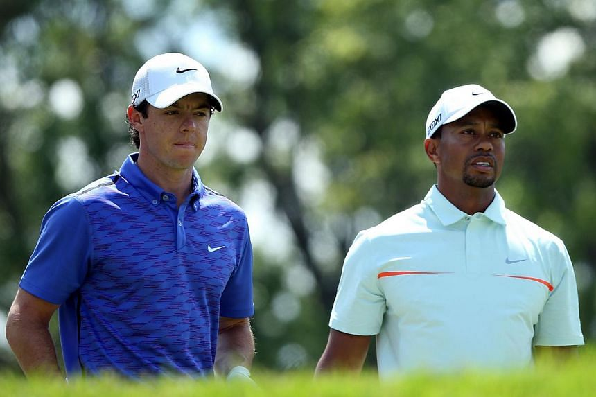 Tiger Woods (right) and Rory McIlroy will go head-to-head in a two-man exhibition for the second time in China, following last year's outlandish Duel at Jinsha Lake, organisers said on Saturday, July 13, 2013. -- FILE PHOTO: AFP