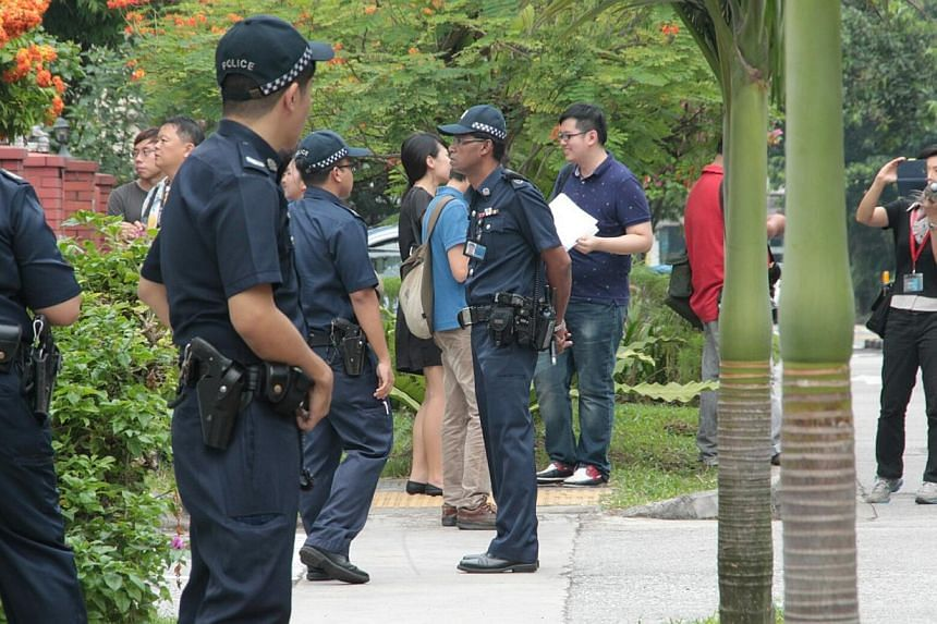 The Kovan murder suspect, 34-year-old Singapore policeman Iskandar Rahmat (not pictured), was taken by police to the crime scene at Hillside Drive at about 2.15pm on Saturday. -- PHOTO: WANBAO