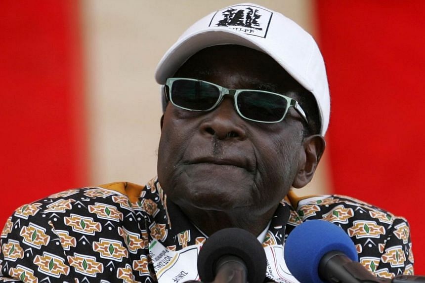 Robert Mugabe, president of Zimbabwe and leader of the political party Zimbabwe African National Union - Patriotic Front (ZANU-PF), addresses an election campaign rally at Nzvimbo growth point in Mashonaland Central province on July 11 2013, where he