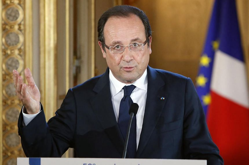 French president Francois Hollande delivers his speech during a visit at the Museum of the Legion of Honnor for the 50th anniversary of the National Order of Merit in Paris, on Saturday, July 13, 2013. Mr Hollande will face tough questions on France'
