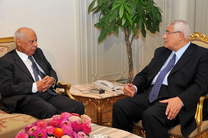 In this handout picture made available by the Egyptian presidency shows Egypt's interim president Adly Mansour (right) meeting with with new-appointed Prime Minister Hazem al-Beblawi, on July 9, 2013 in the Egyptian capital, Cairo. Egypt's new prime