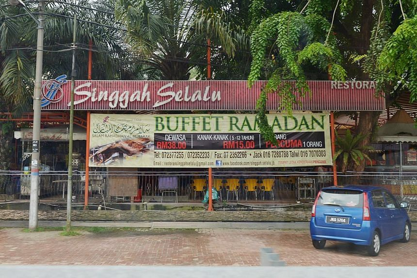 The Singgah Selalu restaurant in Jalan Skudai where the suspect, Iskandar Rahmat, was arrested on Friday night along with another man. Unknown to the two, plainclothes Malaysian police officers had been watching them. -- ST PHOTO: ALPHONSUS CHERN