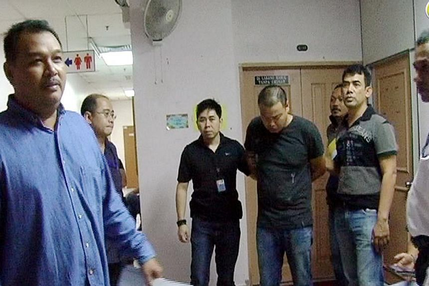 Iskandar was arrested late on Friday night in Johor Baru and taken back to Singapore yesterday. He was declared a bankrupt on Thursday - just a day after he allegedly committed the two murders. He was also facing disciplinary proceedings - which bega