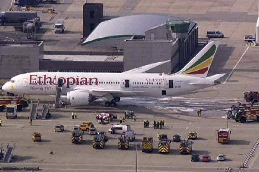 Emergency crews surround a Boeing 787 Dreamliner, operated by Ethiopian Airlines, which caught fire at Britain's Heathrow airport on July 12, 2013. Airlines expressed confidence in the safety of Boeing's 787 Dreamliner on Sunday, July 14, 2013, as in