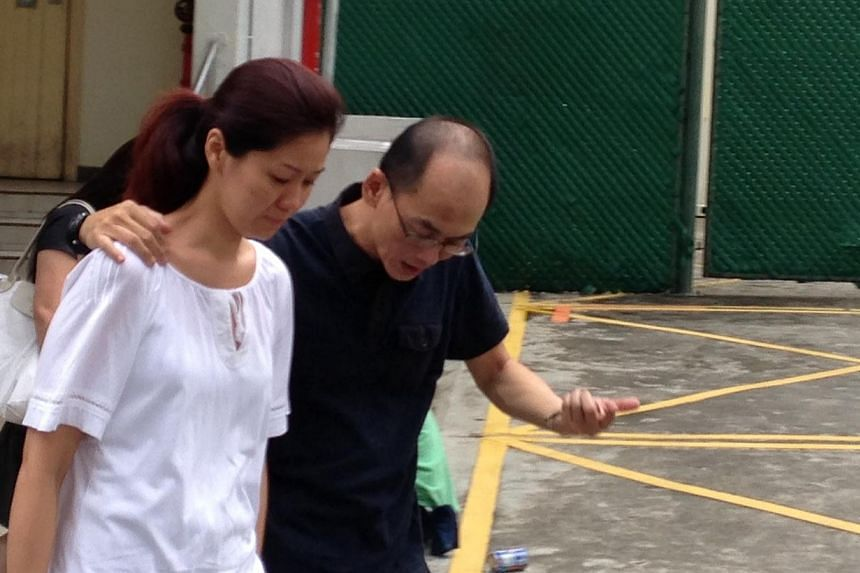It was a tearful occasion as the family of Mr Tan Boon Sin, 67, and Mr Tan Chee Heong, 42 - victims of the Kovan double murder last Wednesday - turned up at the mortuary at 12:35pm Sunday to claim their bodies. -- ST PHOTO: WALTER SIM