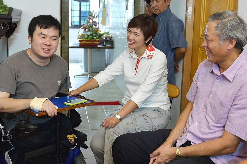 Defence Minister Ng Eng Hen (right) visited injured navy serviceman Jason Chee (left) at his home on Sunday, July 14, 2013, about a month since Mr Chee was discharged from hospital. Dr Ng, who is also MP for Bishan-Toa Payoh GRC, met Mr Chee at