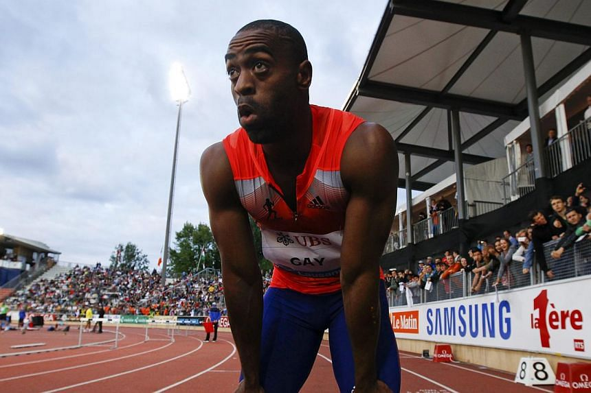 United States' 100 metres record holder Tyson Gay (above) said on Sunday, July 14, 2013, he had tested positive for a substance he could not identify and was pulling out of next month's world championships. -- FILE PHOTO: REUTERS