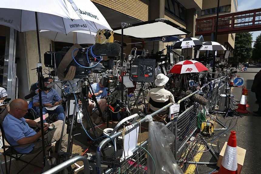 Members of the media wait across St Mary's Hospital's exclusive Lindo Wing in London on Sunday, July 14, 2013.The hospital is ready, the Wikipedia page and Twitter accounts are up and Britain's famously creative press are running out of ideas.