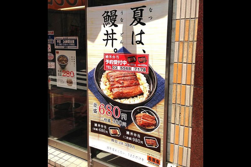 For consumers on a budget, there's Yoshinoya's unadon (bowl of ricetopped with broiled eel) at 680 yen (S$8.60) a bowl. It costs more than twiceYoshinoya's signature gyudon (beef bowl) which is 280 yen (S$3.60), as shown inthe smaller poster. -- ST P