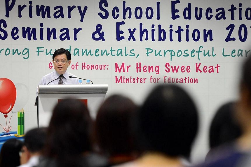 Education Minister Heng Swee Keat speaking to over 2,000 primary school teachers at the Primary School Education seminar held at Republic Polytechnic on July 10 2013. With a new phase of Primary 1 registration starting today and places at popular sch