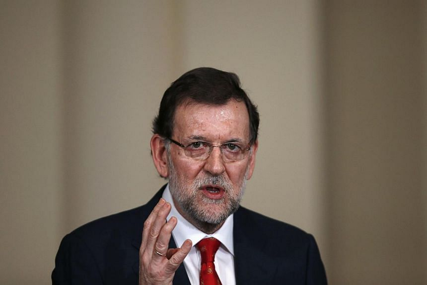 Spain's Prime Minister Mariano Rajoy speaks during a presentation on social action entities at the Moncloa Palace in Madrid on July 11, 2013. Spain's Prime Minister Mariano Rajoy faced calls to resign on Sunday over a slush fund scandal roiling