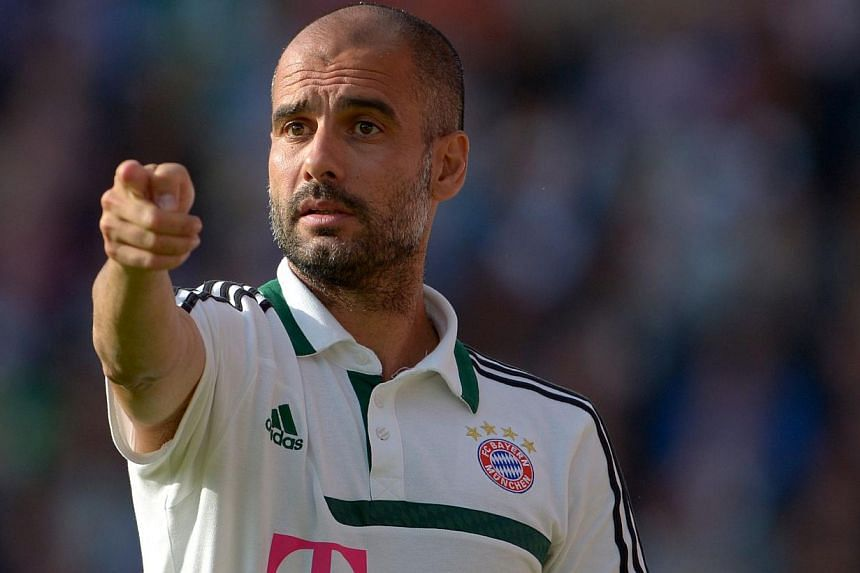 Bayern Munich's Spanish headcoach Pep Guardiola gestures during the pre-season football match Hansa Rostock vs FC Bayern Munich on July 14, 2013 in Rostock, northern Germany.Bayern Munich laboured to a 4-0 win at German third division minnows H