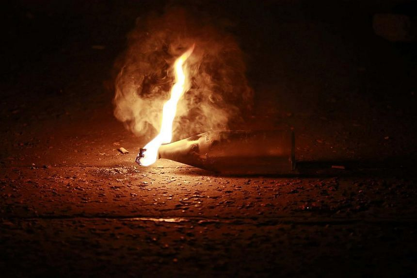 An unexploded petrol bomb is pictured in the Woodvale Road area of North Belfast early July 15, 2013, the third night of unrest after an Orange Parade was blocked from marching past the Nationalist Ardoyne area in Belfast on Friday.-- PHO