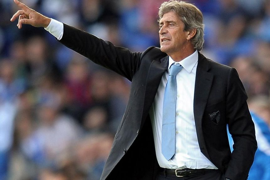 A file picture taken in Cornella on October 27, 2012, shows Malaga's Chilean coach Manuel Pellegrini during a Spanish League football match between RCD Espanyol and Malaga. Manchester City on Friday June 14, 2013.Manchester City hope to have a
