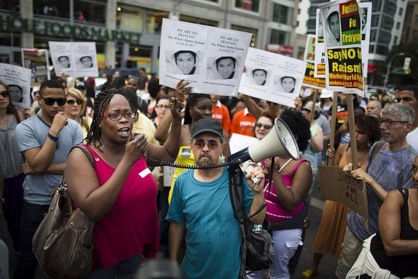 Demonstrators converge on Union Square in New York Sunday, July 14, 2013 during a protest against the acquittal of neighborhood watch member George Zimmerman in the killing of 17-year-old Trayvon Martin in Florida. Hundreds protested in New York