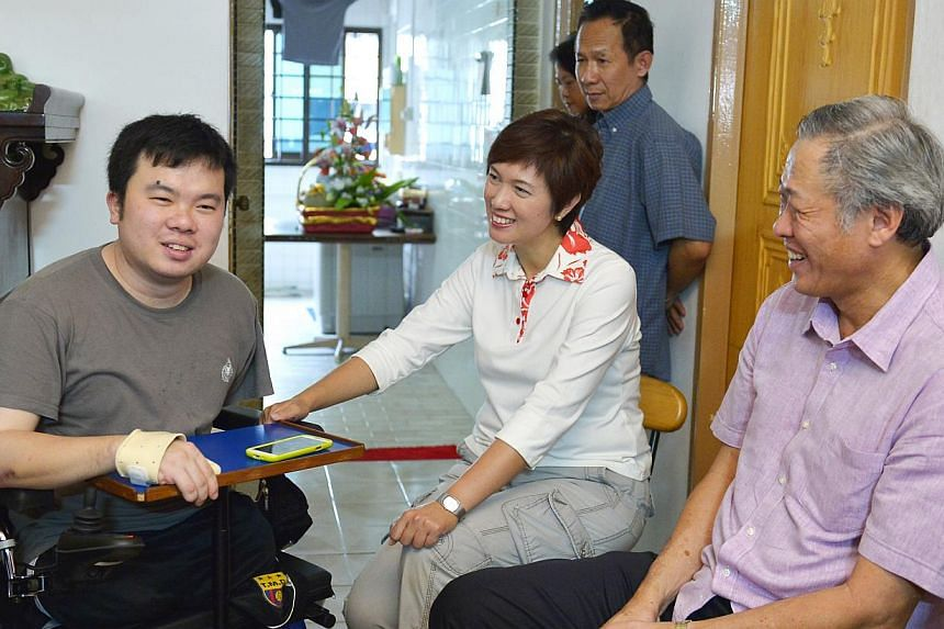 All five MPs for Bishan-Toa Payoh GRC, including Defence Minister Ng Eng Hen (right) and Mrs Josephine Teo, visited Mr Jason Chee (left) in his home yesterday afternoon, as part of a series of house visits in the area. ST