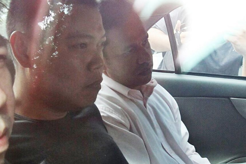 Suspect Iskandar Rahmat, a 14-year veteran of the police force, is expected to be charged today. The 34-year-old has been suspended from the force. -- PHOTOS: SEAH KWANG PENG, LIANHE WANBAO