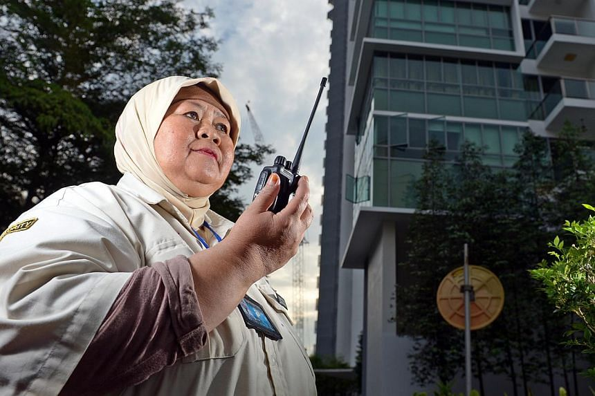 """Madam Latipah Haron, 59, who started off as a restricted-licence guard under the scheme, is now a full-time relief guard. She decided to keep working because """"the boss is supportive, and the work is manageable""""."""