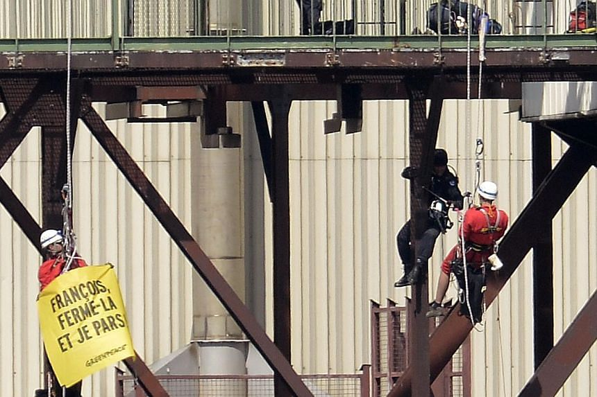 French gendarmes arrest Greenpeace campaigners at the Tricastin Areva's nuclear power plant in the French south-eastern town of Pierrelatte, some 200km north of Marseille, southern France on Monday, July 15, 2013. The police on Monday arrested 29 Gre