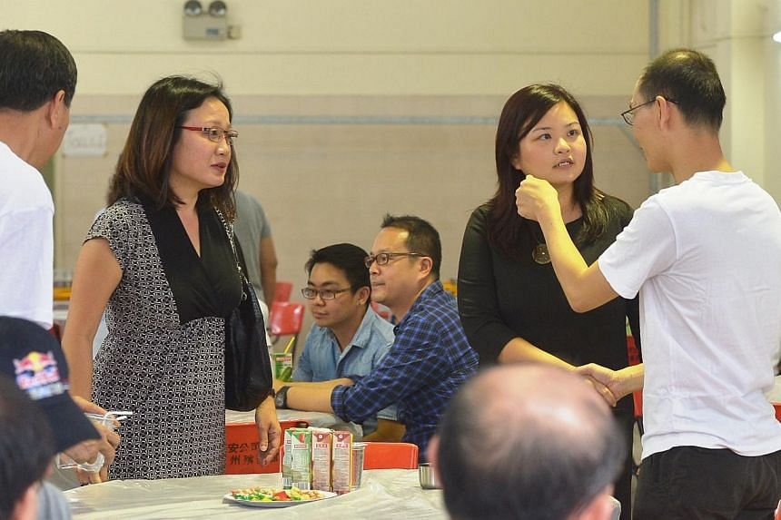 Visitors continued to stream in at the wake of the two victims of last week's Kovan murders.Among them were Workers' Party Members of Parliament Sylvia Lim (Aljunied GRC) (standing, second from left) and Lee Li Lian (Punggol East SMC) (standing