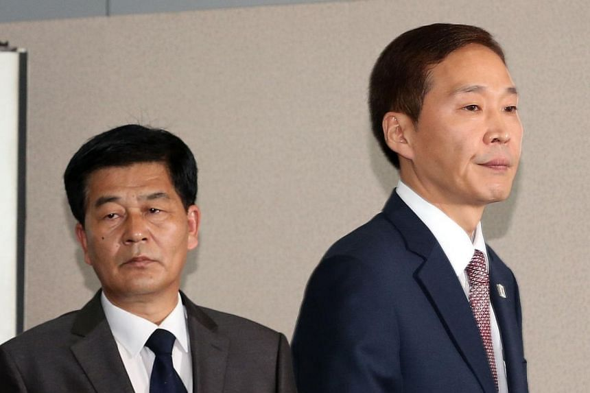 South Korea's chief delegate Kim Ki Woong (right) and his North Korean counterpart Pak Chul Su attend a meeting at the Kaesong industrial complex in North Korea on Monday, July 15, 2013. North and South Korea failed on Monday to reach agreement on re