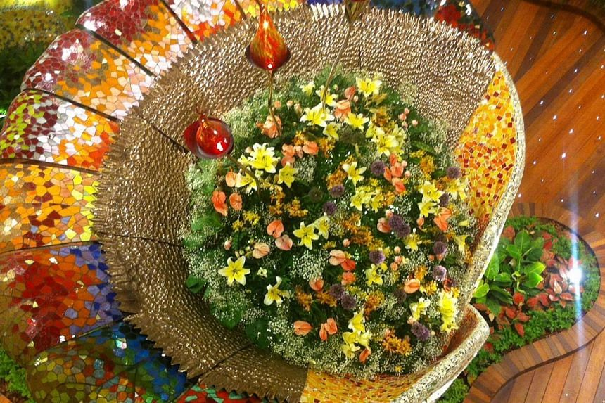 One of the four stained glass mosaic bouquets in Changi Airport's new multi-sensory garden, the Enchanted Garden at the T2 departure transit mall. -- ST PHOTO: KASH CHEONG