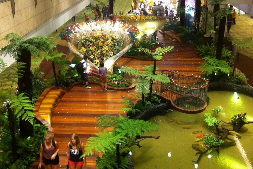 Changi Airport's newest multi-sensory garden, the Enchanted Garden, at its T2 Departure Transit Mall. -- ST PHOTO: KASH CHEONG