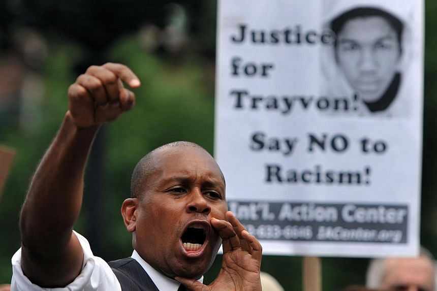 A man speaks during a demonstration at Union Square in New York on July 14, 2013. Protests were held one day after a US jury found George Zimmerman not guilty of murdering unarmed black teen Trayvon Martin on February 26, 2012, in a racially charged