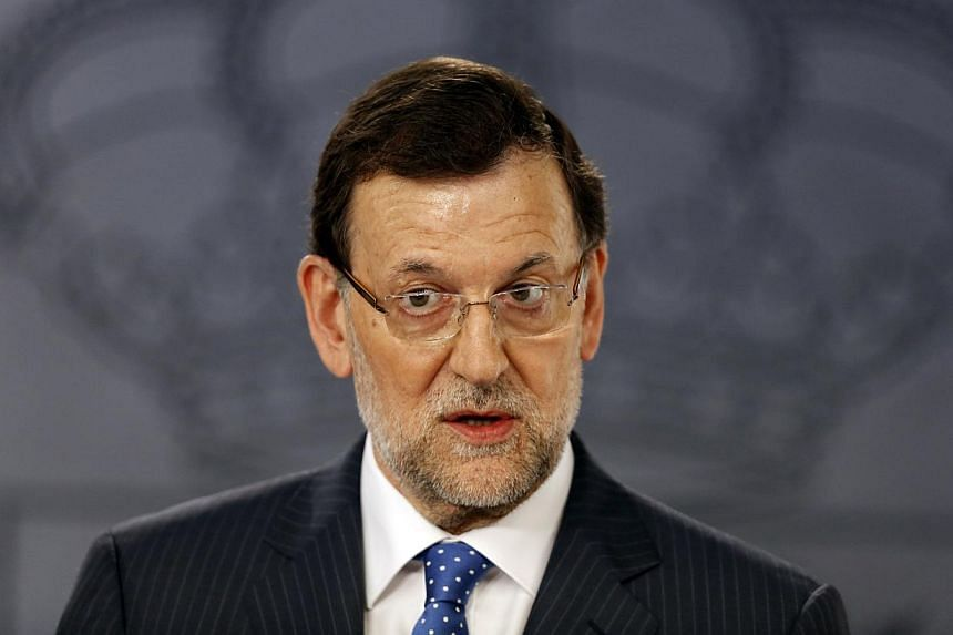 Spain's Prime Minister Mariano Rajoy (above) speaks during a news conference at Moncloa Palace in Madrid on Monday, July 15, 2013.Spain's Prime Minister Mariano Rajoy refused on Monday to resign over a corruption scandal rocking his government