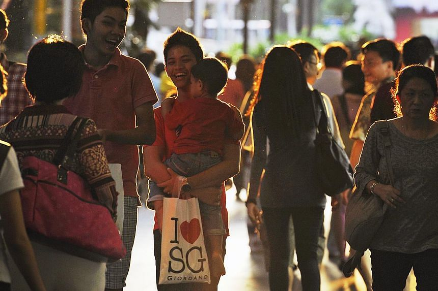 Shoppers outside Lucky Plaza, Orchard Road. -- ST FILE PHOTO: NURIA LING